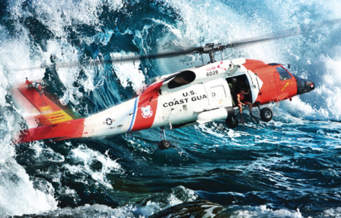 Coast Guard chopper near water waves