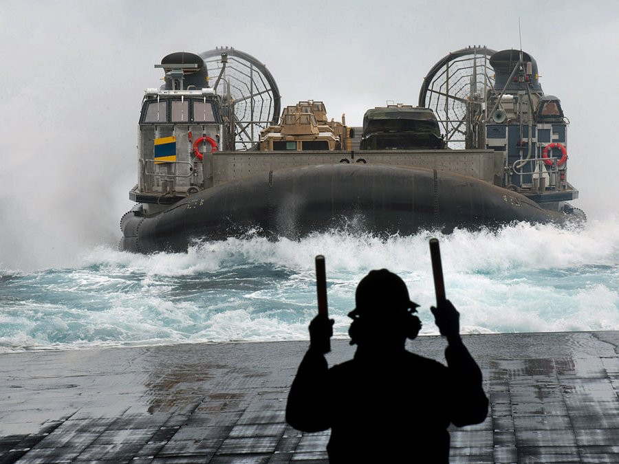 here-a-landing-craft-air-cushion-lcac-hovercraft-prepares-to-enter-the-uss-new-orleans